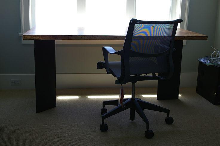 Tribal desk: Western maple slab set on blackened steel tri-legs. Designed by Kirk Van Ludwig. Paired with Setu Chair by Herman Miller.