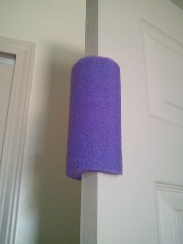"""Inexpensive Toddler Proof Door Stopper - use a pool noodle! No more"
