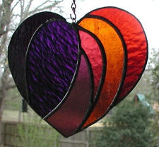 Stained Glass HEART SUNCATCHER......would work well for a hooked rug