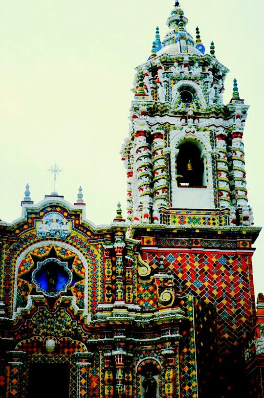 Temple of San Francisco Acatepec near San Andrés Cholula, Puebla, Mexico. Built at the end of the 18th Century, the entire façade of this churrigueresque church was elaborated using individually crafted pieces of talavera tiles from Puebla.