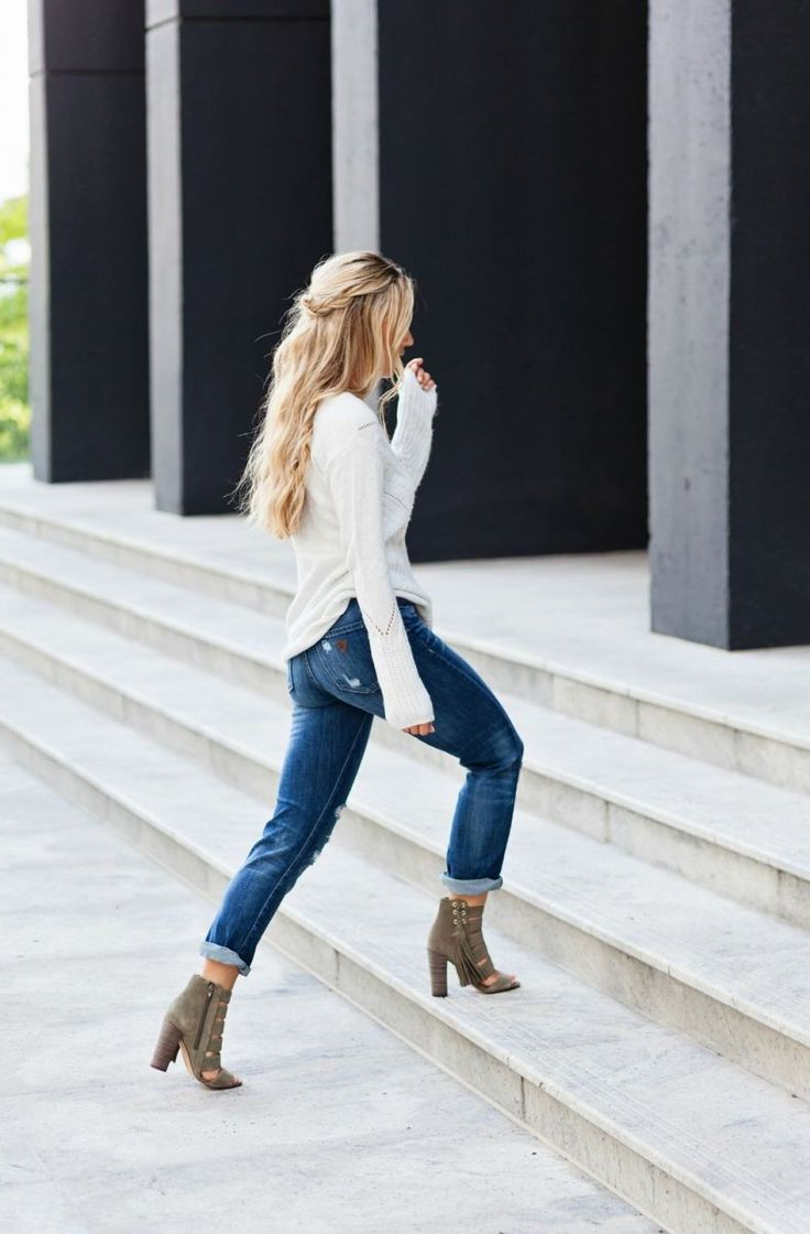 distressed denim with cozy sweater