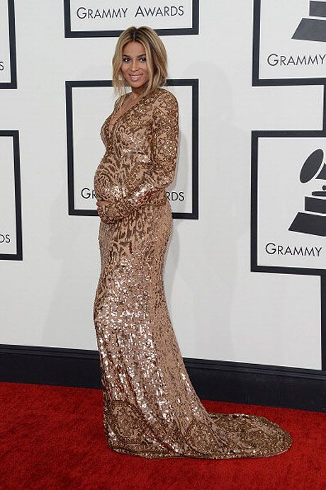 gold metallic dress: A pregnant Ciara wears gold metallic Pucci gown