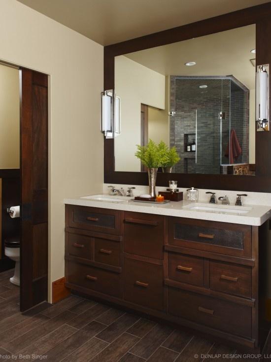Dark tile floors with dark cabnits and dark wood trim.  I really like this.Dark Wood, Pocket Doors, Bathroom Ideas, Traditional Bathroom, Bathroom Interiors Design, Dunlap Design, Design Group, Wood Tile, Master Bathroom