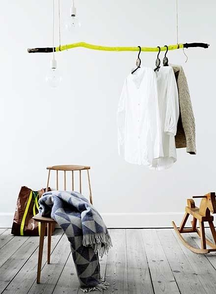 Neon Painted Driftwood Stick Cool alternative way to store extra clothes