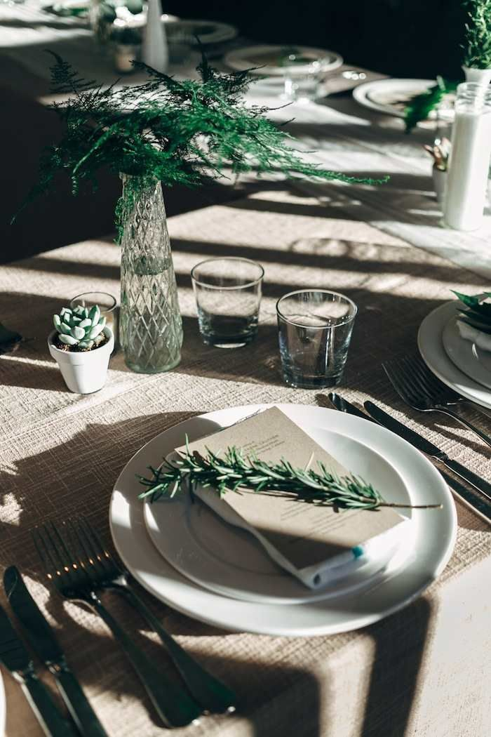 Natural style wedding table setting in green and white. Photo: Joel Bedford