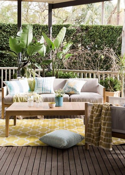 Cosy covered outdoor spaces - Just as cushions and rugs add cosiness to your indoor space, so they'll do the same for your outdoor zones; look for weatherproof materials for longevity. Home Beautiful