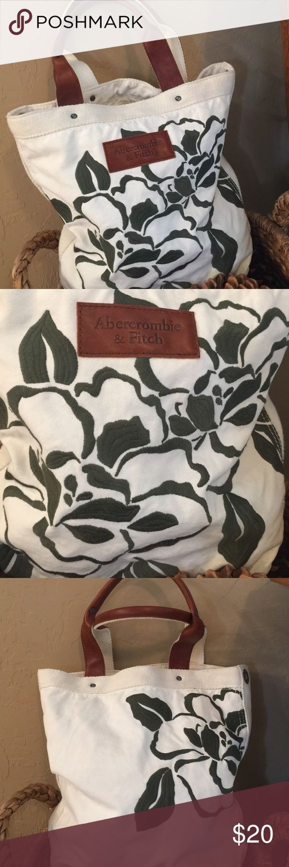 🌿Abercrombie & Fitch Tote Bag🌿 🌿Abercrombie & Fitch....Bag ..Off/White with Beautiful green embroidered flowers..on front and back...Leather/Canvas handles..Inside Zipper pocket, 1- slot pocket, with a fastener...Very nice material weight 🌿 Abercrombie & Fitch Bags Totes