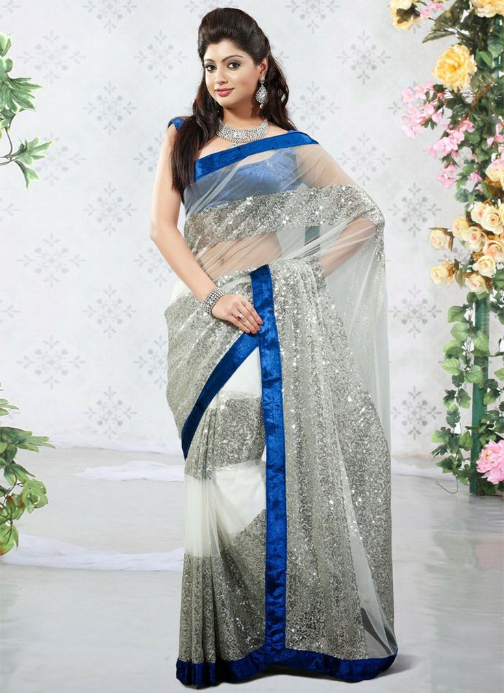 Everyone Will Admire You When You Wear This Clad To Elegant Affairs. Be Your Own Style Icon With Captivating Off White, Silver Net & Super Net Saree. This Attire Is Beautifully Adorned With Sequins & Velvet Patch Work.