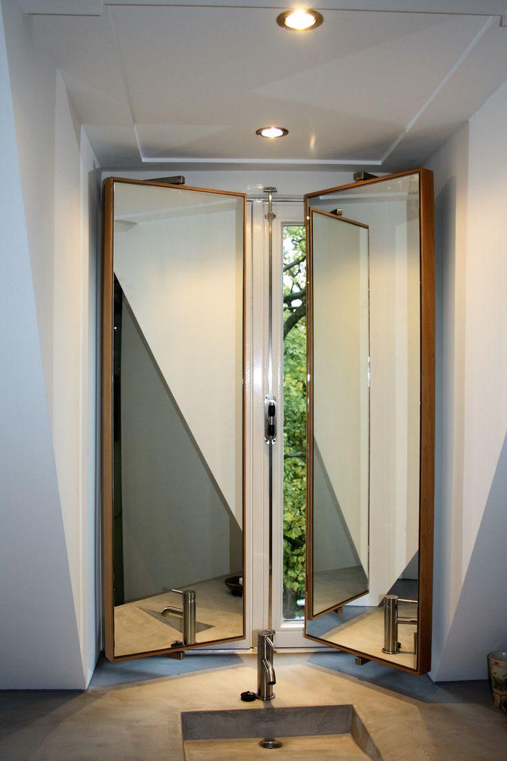 Swiveling mirror lamelpanels