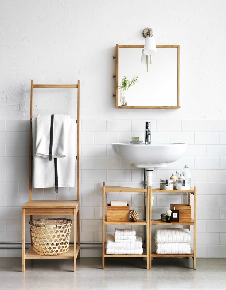 Renters with a pedestal sink (especially with exposed plumbing) may lament a lack of undersink storage. If this is you — try two RAGRUND sink shelves pushed together to fit around your plumbing and, voila!, instant storage. If you have space for a chair, the RAGRUND chair's high back serves as a towel rack — one less screw in the wall. Another hole-less towel rack solution is the standing GRUNDTAL towel rack.