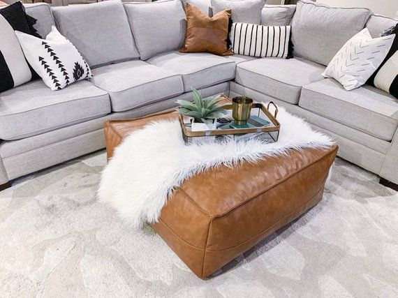 This Golden Brown Faux Leather Ottoman Can Also Be Used For
