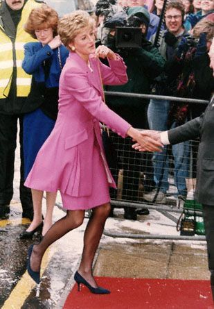 February 14, 1994:  Princess Diana arriving to open a newly refurbished wing at Great Ormond Street Hospital for Sick Children in Central London. This is the only listed official engagement of the year and around 200 people braved the snow and icy winds to greet her arrival. The normal police outrider motorcycles were cancelled due to icy roads created by temperatures as low as 5C (23 degrees F.) that had swept Southern England. (AP Photo/Alistair Grant)