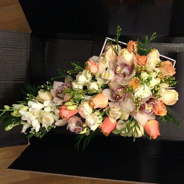 Rose bouquet incorporating pink and white Cymbidium Orchids (large) with white Singapore Orchids and wax greenery.