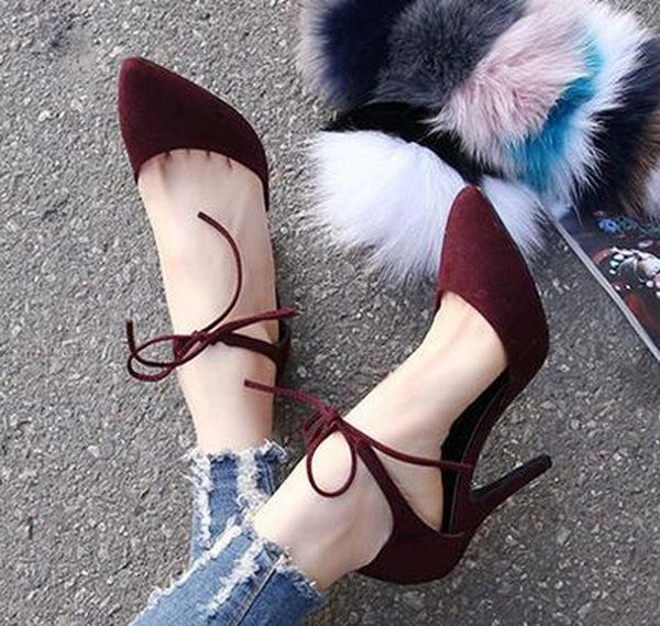 Ankle straps are sexy to look at. But it's even sexier with this straps you really have to tie into a knot. Plus it's a deep red suede shoes. Really makes you feel sexier.