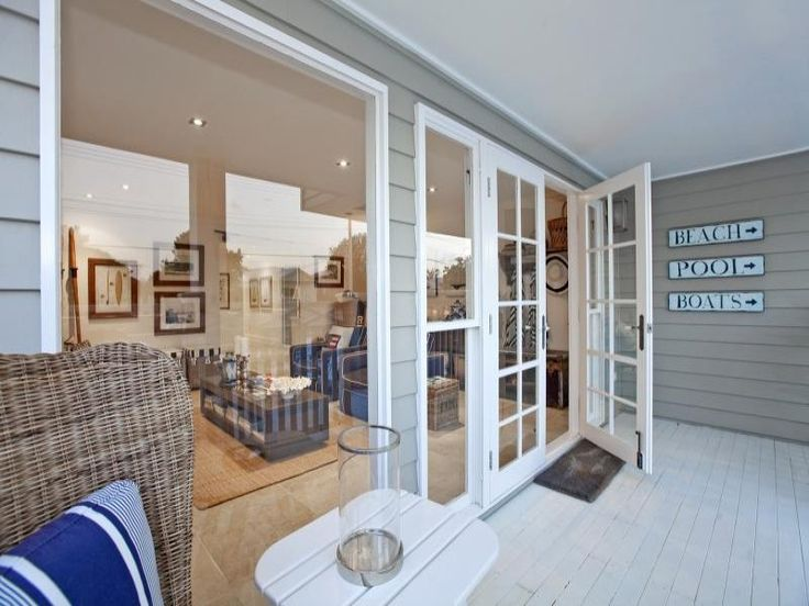 just love the colonial bar French doors leading out onto the verandah of this Brisbane home #hamptonsstyle