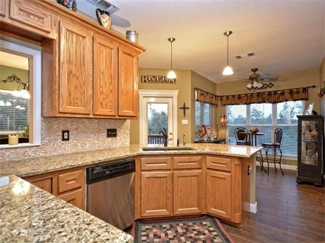 Traditional Kitchen With American Woodmark Reading Oak Honey Cabinets Ms International Autumn Beige Granite