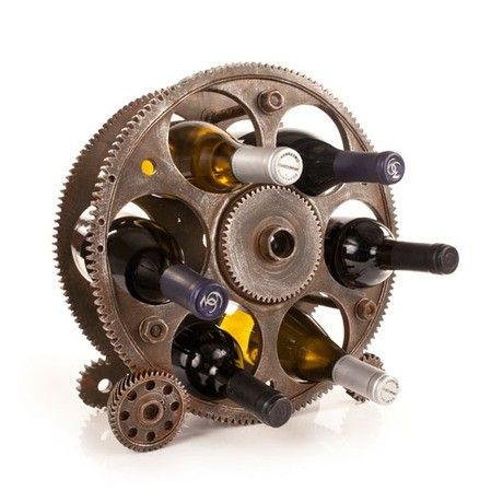 Shouldn't your wine rack be as interesting as the wine it holds? This one goes for mega impact with eye-catching industrial style. Made of oversized reels and gears, it demands attention and to be filled with six bottles of your favorite vino.