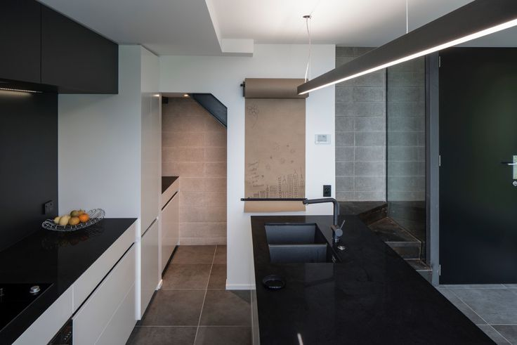 The Kitchen Features Caesarstone Jet Black Benchtops And