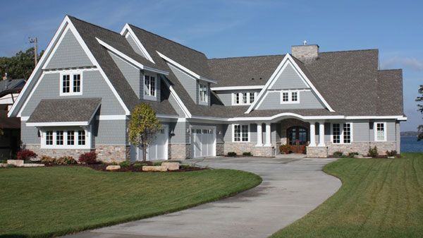 You won 39 t find a more impressive cape cod home design than for Two story cape cod