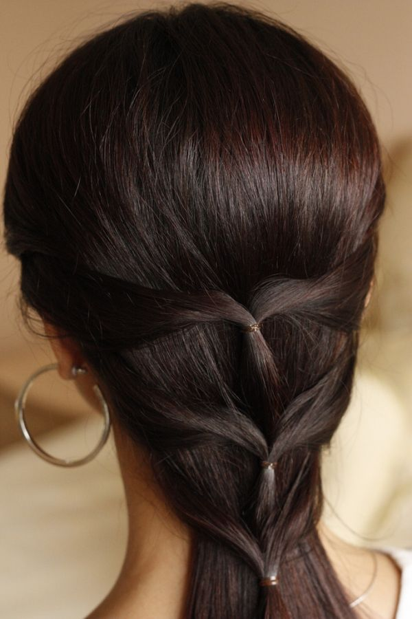 quick, pretty hairstyle. You know the half ponytail? Make a small one. Go a little further down. Make another. A little further down, make a third. Done! This would look cute with added sparkle spin pins!