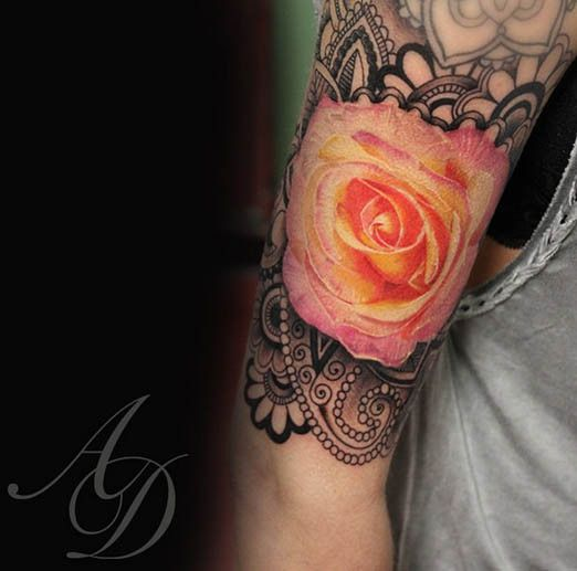 This mandala makes the yellow and pink rose pop off the skin.