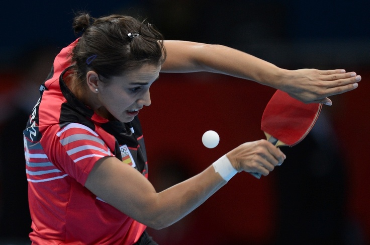 Spain's Sara Ramirez serves to Ukraine's Margaryta Pesotska during a table tennis women's singles preliminary round match of the London 2012 Olympic Games at the Excel centre in London July 28, 2012. AFP Photo / Saeed Khan        (Photo credit should read SAEED KHAN/AFP/GettyImages)