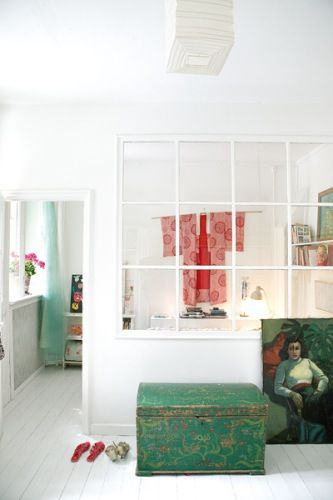 I like the window dividing the room.