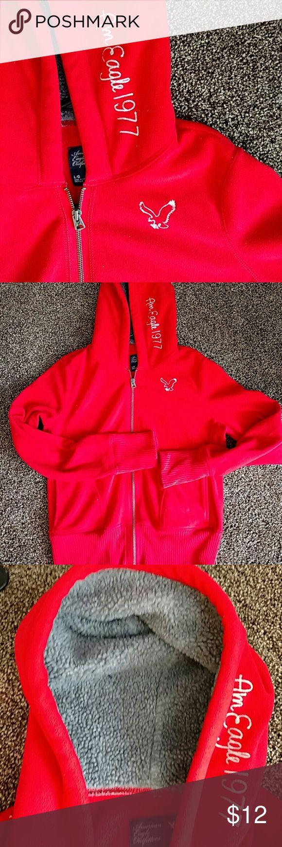 American eagle red zip up hoodie Very warm red zip up  fleece hoodie. Great condition. Warm hood. American Eagle Outfitters Tops Sweatshirts & Hoodies