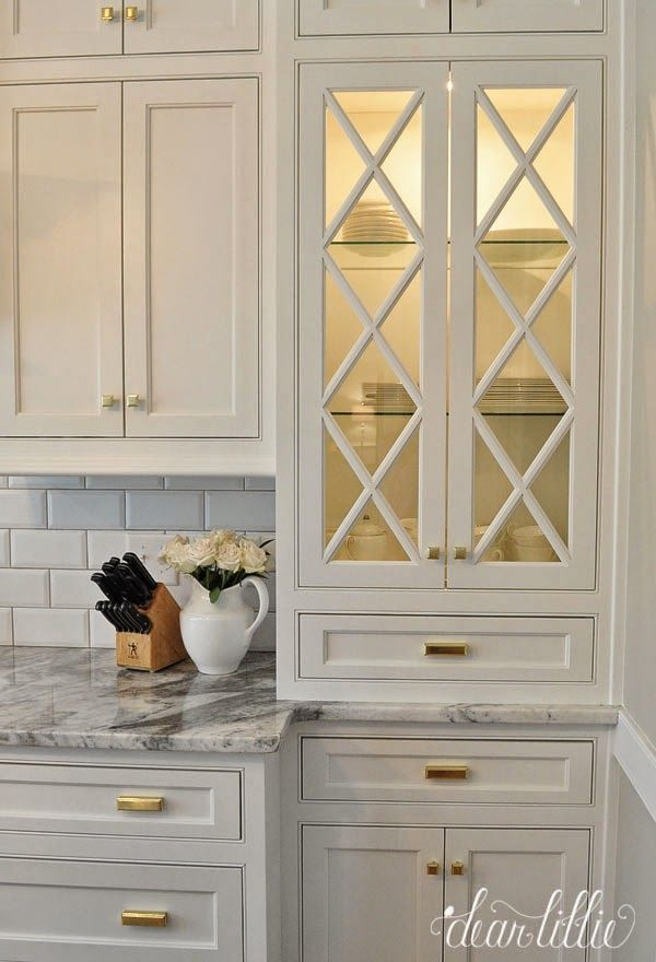 A Classic and Timeless White Kitchen  by Dear Lillie...criss cross in the window next to stove