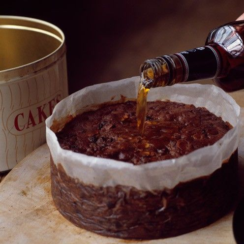 Christmas Cake with a Hint of Dark Chocolate :   250 g each sultanas and raisins 125 g each Agen prunes and organic ready-to-eat apricots, chopped 50 g (2oz) candied fruit, chopped by hand 150 ml (5fl oz) dark rum, plus 1tbsp to soak Zest and juice of 1 orange 175 g (6oz) each dark muscovado sugar and softened butter, plus extra butter to grease 4 medium eggs, beaten 125 g self-raising flour 1 tsp mixed spice ½ level tsp cinnamon 75 g dark 85% choc