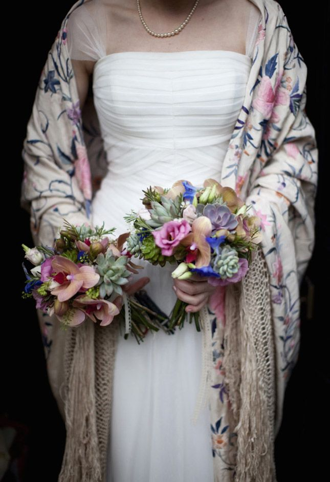 When she couldn't find the perfect wrap, this bride took to eBay to find this vintage embroidered piano shawl. Her florist even used it as inspiration for the bouquets!