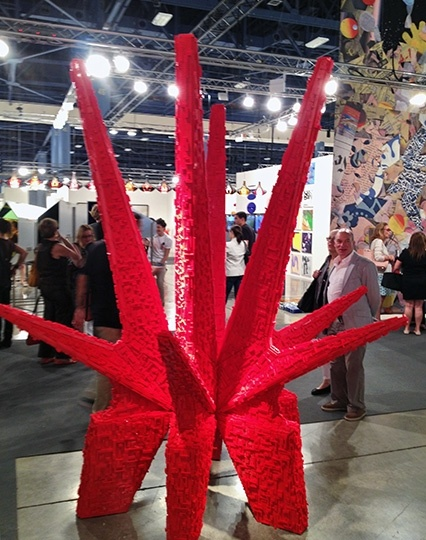 "Sean Kelly - Los Carpinteros steal the gallery booth and possibly the entire fair with one of their fun, magnificent new sculptures. ""Kosmaj Toy"" (2012) is a soft parody of Communist-era monuments, made of pieces of bright red Lego, Art Basel Miami 2012"