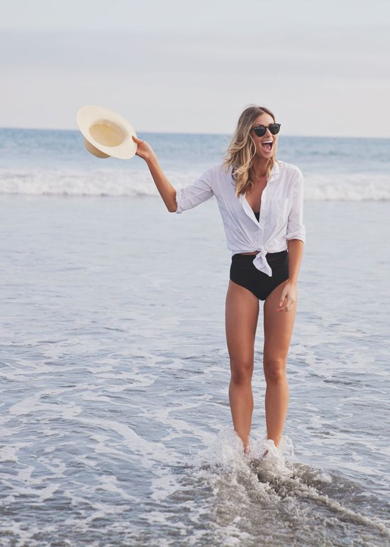 Layer a white shirt over a swimsuit for instant chic
