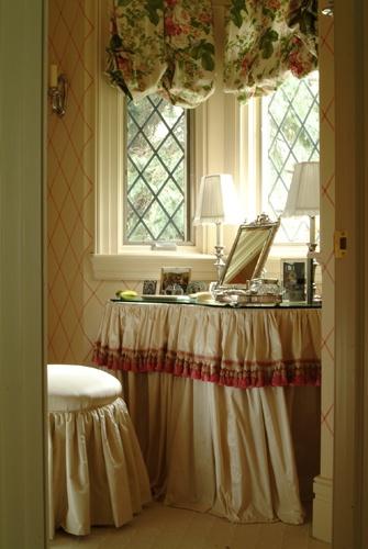 Skirted vanity, balloon valance, gathered upholstered stool, leaded glass windows, sconce - Jenny Bova Associates