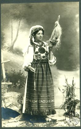 Leopold Adler - Costum popular românesc din Tulgheş, tânără nevastă torcând  between 1900 and 1920  The Romanian Academy Library