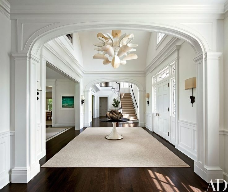 In the entrance hall, the Shelton, Mindel team offset Stern's traditional architecture with a Mauro Fabbro parchment light fixture from Casati Gallery | archdigest.com