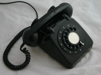 SCP-086 - A collective sessile organism whose component parts resemble items of office equipment from 1978, and which contains a consciousness claiming to be that of former Foundation administrator Dr. [REDACTED] (1907-1978). Its 8 (eight) components are: a rotary telephone (SCP-086-1), a wall-mounted pencil sharpener (SCP-086-2), a desk stapler (SCP-086-3), a microfiche reader (SCP-086-4), a water cooler (SCP-086-5), a filing cabinet (SCP-086-6)...
