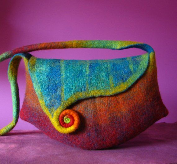 This bag has been wet felted from fine quality Australian merino wool. Silk fabric has been incorporated into the fabric of the felt and adds even