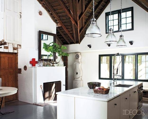 A barn kitchen with pendant lights by Urban Archaeology.
