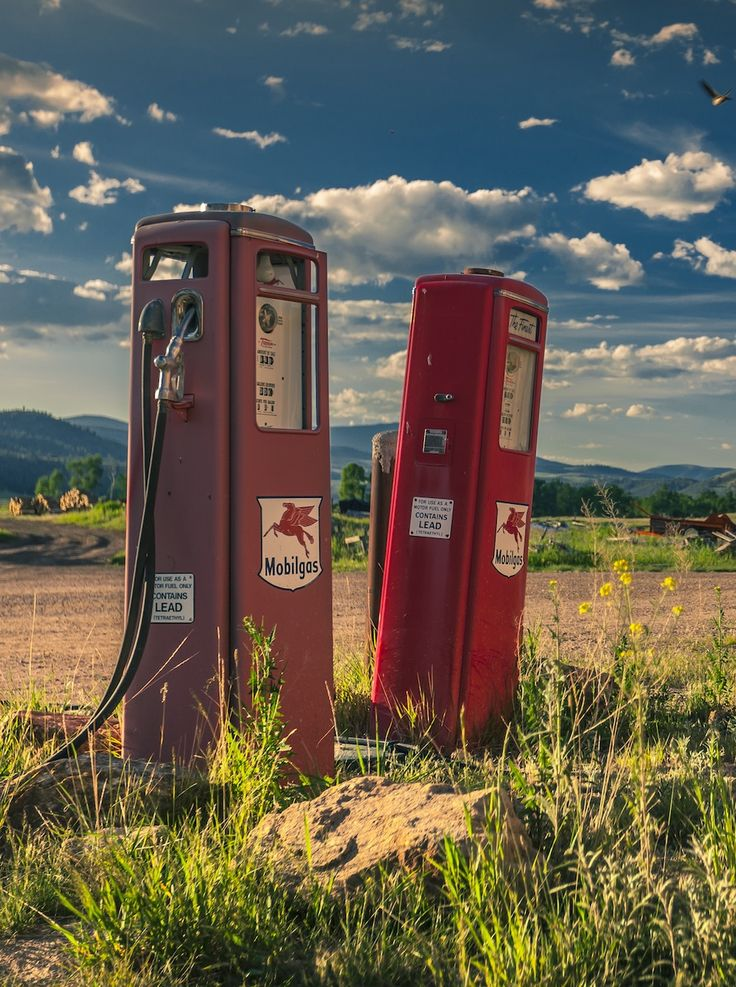 Tucked into corners of our 6,600-acre ranch are vestiges of times past, like these antique fuel pumps. Having your own fuel source is essential for farms and ranches secluded in the Montana mountains. Yet, times do change and we also house a Tesla charging station for guests who arrive powered by electricity, and walking and biking are the the main modes of transport during a Ranch stay. Photo by Robert Cole Photography