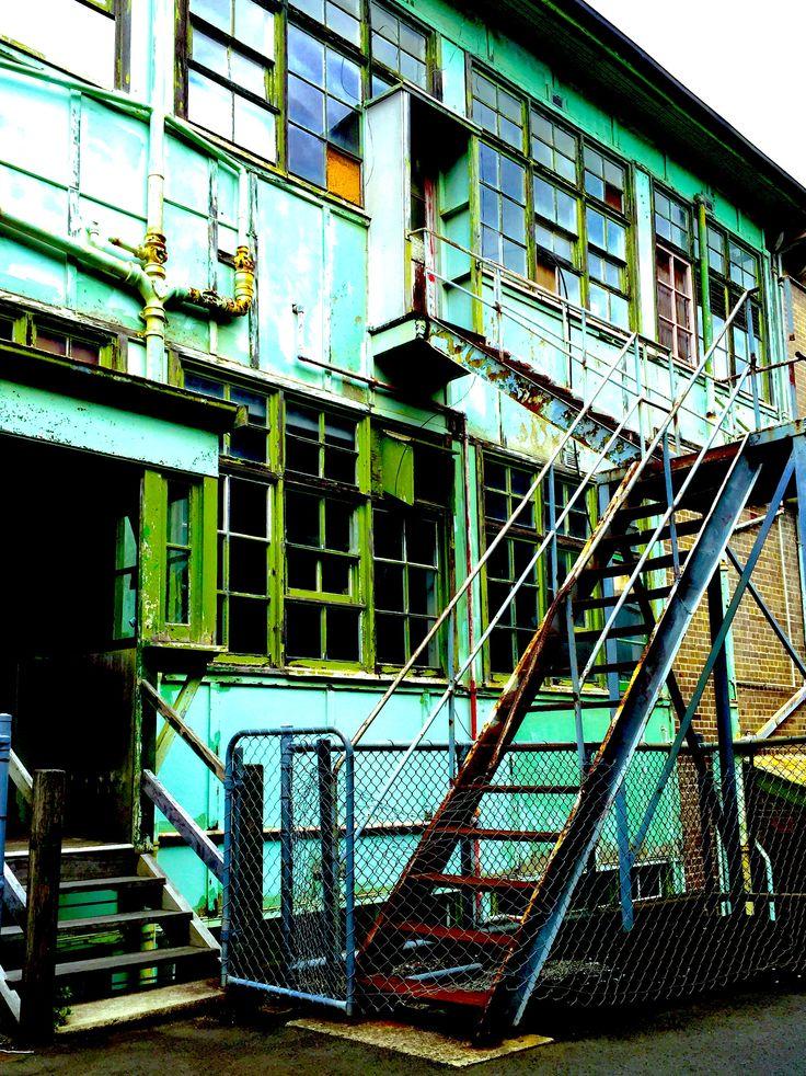 Decaying green facade on Cockatoo Island