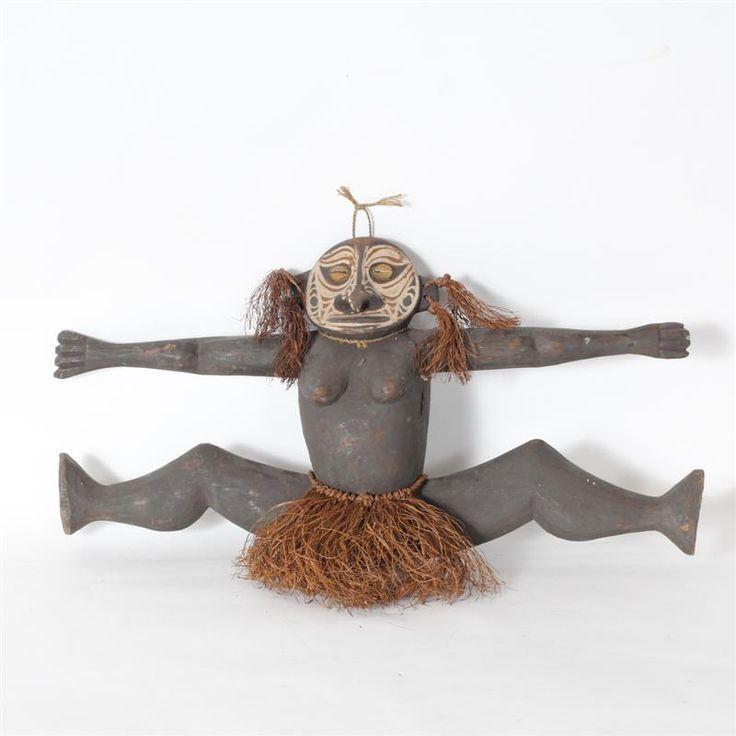 "Papua New Guinea; Sepik River split-leg female figure carving; polychrome with shell and fiber ornamentation. H 15"" x W 23"""
