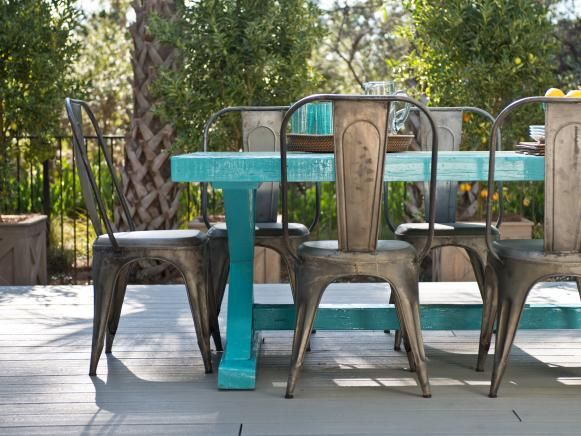 "the ""look"" for outdoor dining table- turquoise table made from recycled plastic, matched with galvanized chairs of some sort."