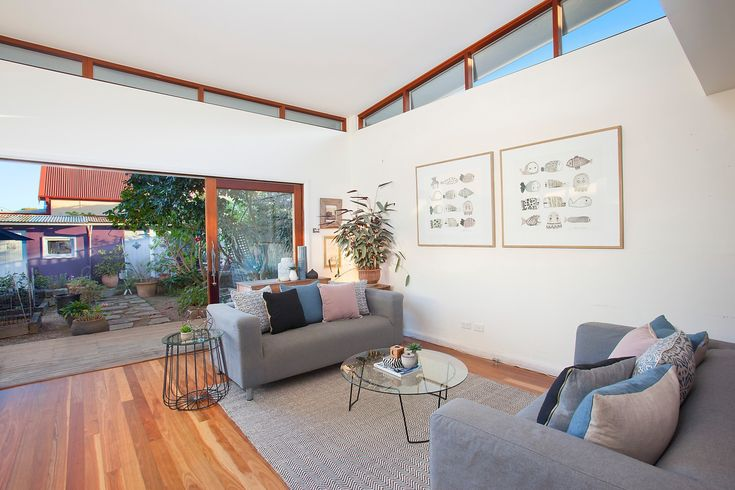 Large open-plan family living & dining area, wall art, lounges, cushions, floor rug, coffee table, side table, indoor plant, Pilcher Residential