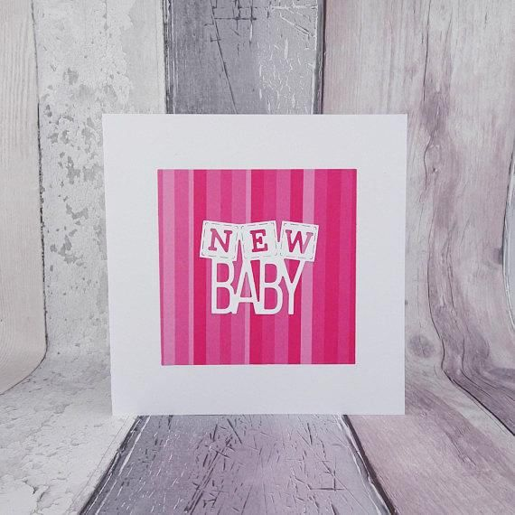 This handmade modern new baby girl card features a shades of pink stripes on a square topped with a pure white sentiment that reads: New baby featuring building blocks. This is a fantastic card to say congratulations to new parents on their newborn baby or for a baby shower.  This card is one of the most luxurious in my range, with a weight of 380 gsm with a 150 gsm weight envelope.  Please note that due to the unique pattern on the paper, each card will appear very slightly different with…