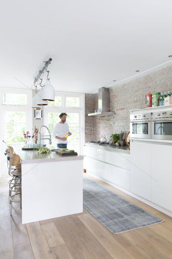 Modern white #kitchen with exposed brick #interior