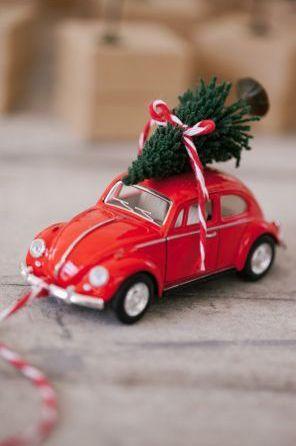 toy volkswagon bug with christmas tree on top