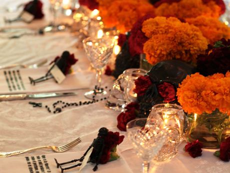 Day of the Dead party settings--use a high-gloss spray paint to coat plastic and Styrofoam skulls you picked up on Olvera Street. Throw white lace over white muslin for a tablecloth that pays homage to the popular Day of the Dead skeleton bride.