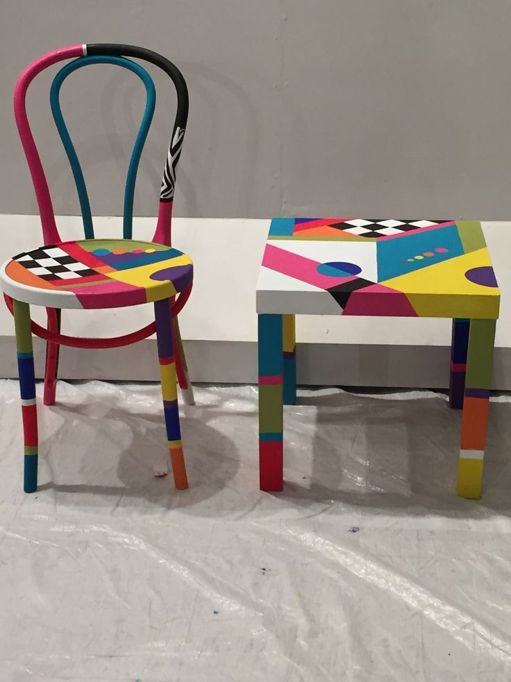 Hand painted wooden chair and table made and sold on an artists workshop in Kuwait. Made by Artist Bazza Albateni.( Baz Batini)