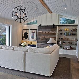 Beach Chic Living Room Sliding Barn Door Hiding Tv Built In Shelves